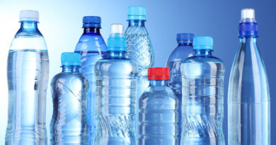 Group plastic bottles of water on blue background; Shutterstock ID 88913350; PO: aol; Job: production; Client: drone